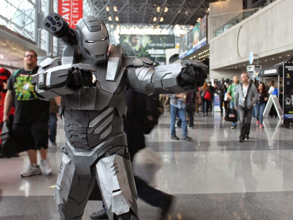 on a showroom floor full of red iron men this silver war machine suit is prepped for battle