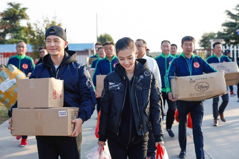 Huang Xiaoming and Angelababy do charity