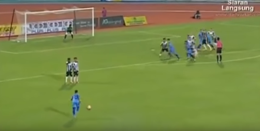 Malaysian footballer gains international attention with miracle kick