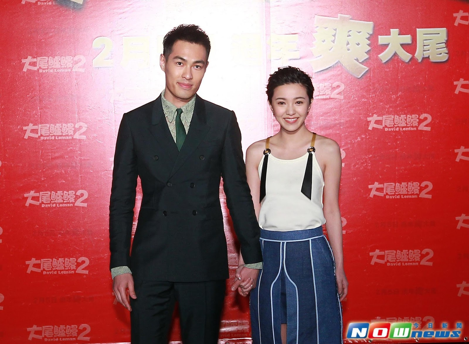Amber Kuo and Tony Yang hold hands at movie premiere