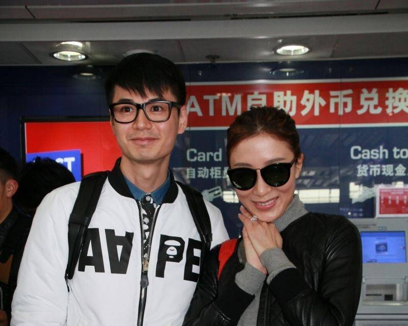 Him Law and Tavia Yeung return to HK as newlyweds