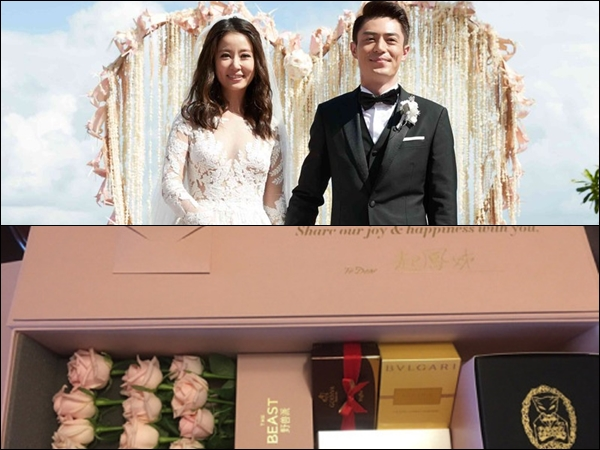 Ruby Lin and Wallace Huo give out gift boxes