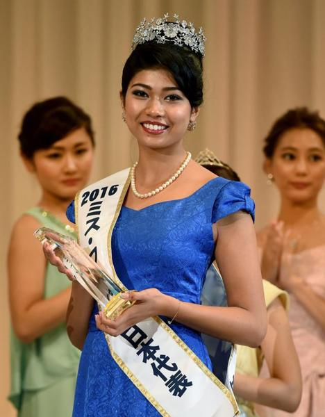 Elephant trainer is crowned Miss World Japan