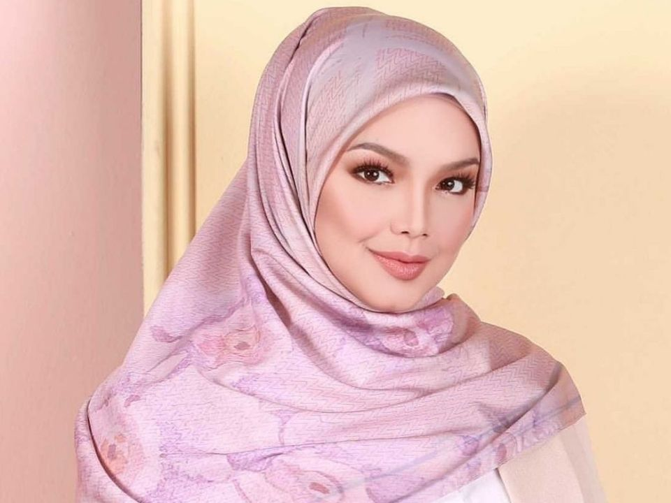Siti Nurhaliza reveals son's name on his seventh day