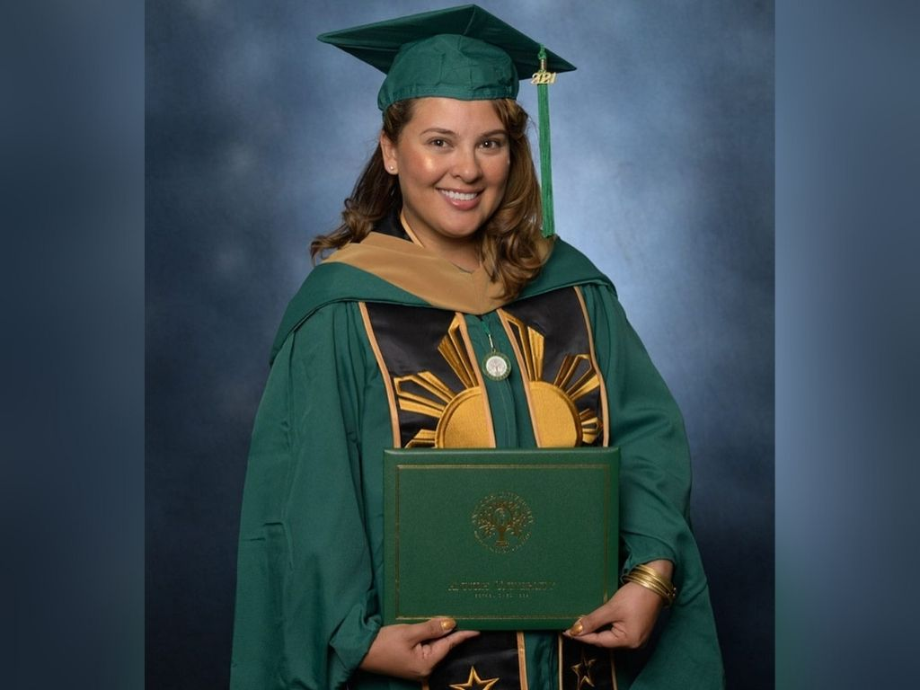 G Töngi receives Master's degree from Antioch University